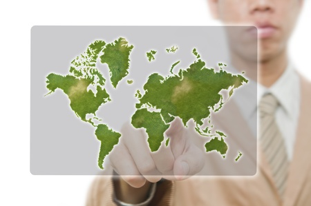 Businessman point finger on world map photo