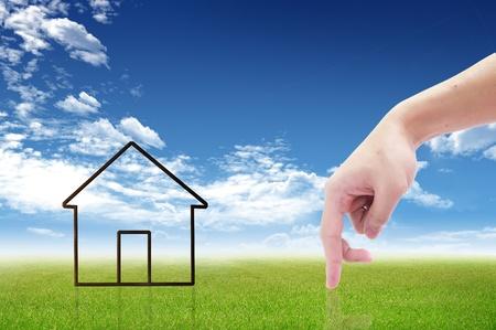 rent index: The House and hands with blue sky as a symbol of the real estate business.  Stock Photo