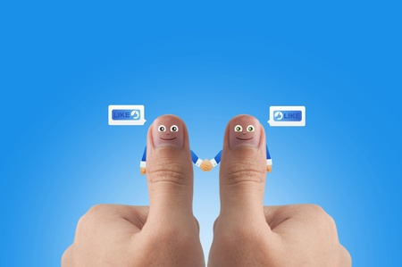 Smiling cartoon face on human thumb up on background,HUMAN RESOURCE photo