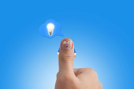 pleased: Smiling cartoon face on human thumb up on background
