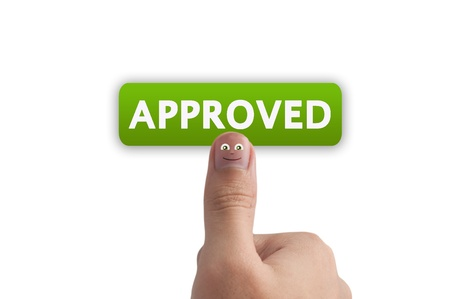 validation: Smiling cartoon face on human thumb up on background