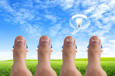 Smiling cartoon face on human thumb up on background, thinking and ides concept Stock Photo - 10473596