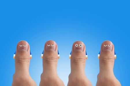 ides: Smiling cartoon face on human thumb up on background, thinking and ides concept