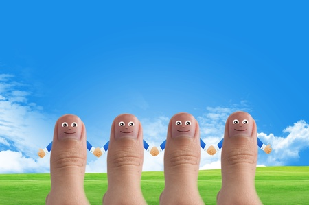 www arm: Smiling cartoon face on human thumb up on background, thinking and ides concept