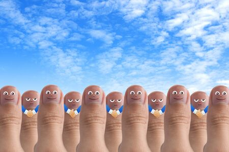 Smiling cartoon face on human thumb up on background, thinking and idea concept photo