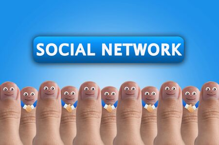 Smiling cartoon face on human thumb up on background, SOCIAL NETWORK photo