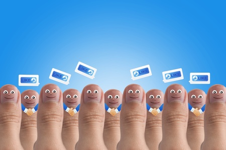 Smiling cartoon face on human thumb up on background, SOCIAL NETWORK Stock Photo - 10473488
