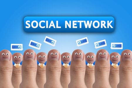 Smiling cartoon face on human thumb up on background, SOCIAL NETWORK Stock Photo - 10473517