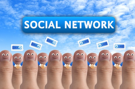 Smiling cartoon face on human thumb up on background, SOCIAL NETWORK Stock Photo - 10473589