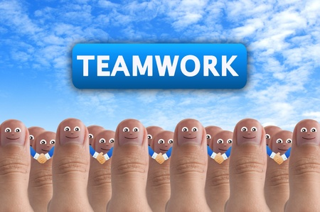 pleased: Smiling cartoon face on human thumb up on background, TEAMWORK
