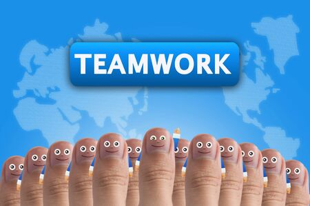 www arm: Smiling cartoon face on human thumb up on background, TEAMWORK