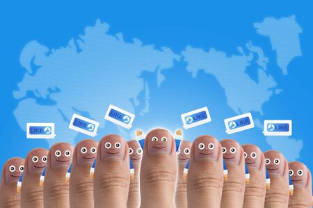 Smiling cartoon face on human thumb up on background, TEAMWORK Stock Photo - 10473599