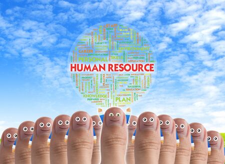 Smiling cartoon face on human thumb up on background WITH TAG CLOUD BUSINESS WORDS photo