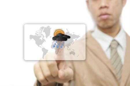 Businessman pressing finger on weather forecast button Stock Photo - 10473337