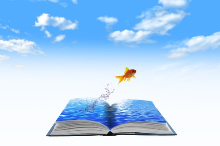 Golden fish jumping across water book, conceptual idea photo