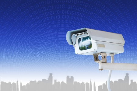 electric system: Security Camera or CCTV on blue digital background Stock Photo