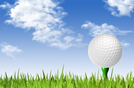 Golf ball on tee off over the green grass and clouded sky photo