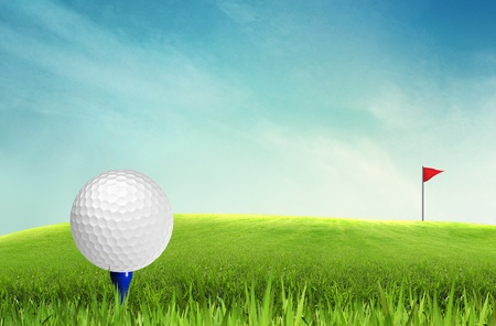 golfcourse: Golf ball on tee off with blue sky background Stock Photo