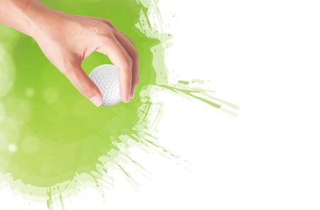 golf green: Close-up of hand holding golf ball with green grass for web design background