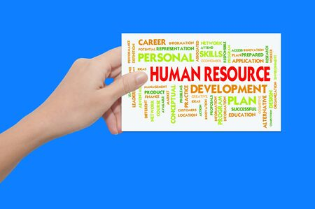 Hand holding paper with business wordcloud , human resource photo