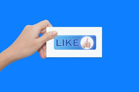 a male hand holding a like business card Stock Photo - 10489324