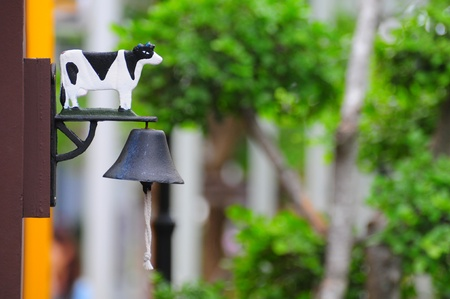 Decorated bell with cow photo