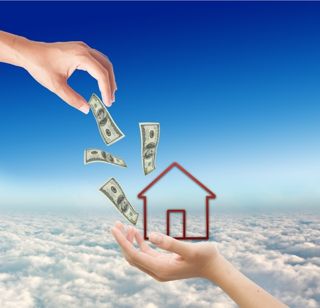 Hands sending money to buy house on blue background, realestate concept photo