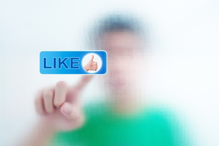 finger pressing Social Network icon on like button Stock Photo - 10490440