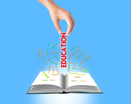 wording: Hand holding business concept with splash wording on book, education