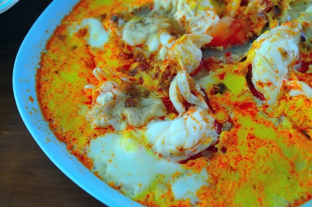 The fired curry shrimp with milk thai food photo