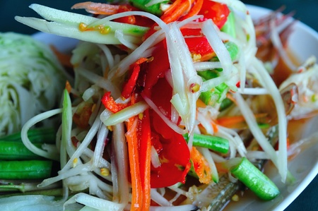 unripened: plate of Thai papaya salad also known as som tam
