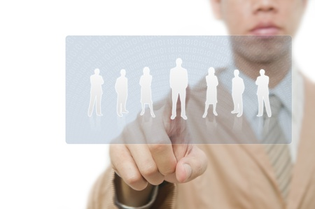 Businessman point finger on group pf people button Stock Photo - 10785398