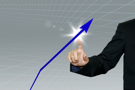 Business man pointing a growing graph on the screen background Stock Photo - 10785404