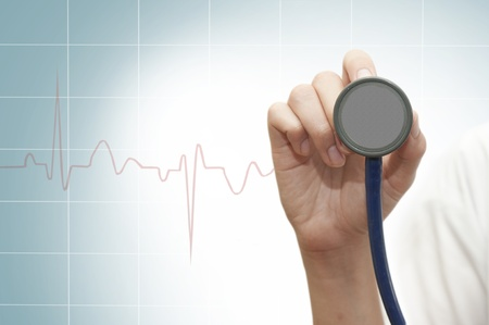 Stethoscope in young female doctor hand photo
