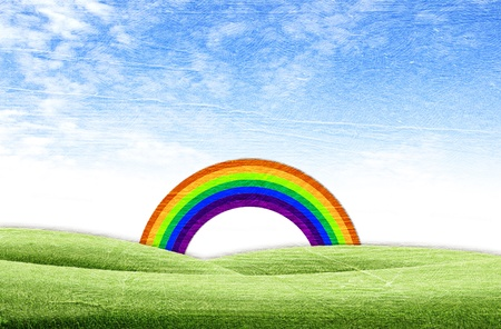 Beautiful rainbow on green grass over the blue sky background photo