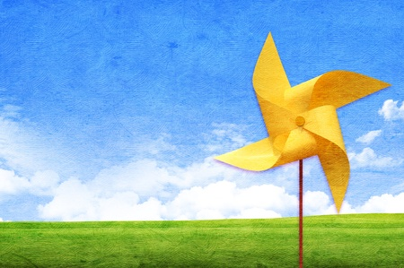 pinwheel toy: Colorful windmaill toy on the screen background, for ecology idea and concept