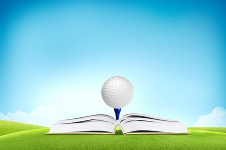 fairway: Golf ball on book tee off with green grass field over the blue sky background
