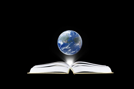 bible backgrounds: Book in the dark room with light and earth  - education concept