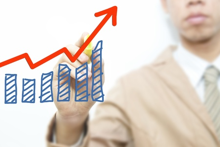 Business man draw graph on the screen background Stock Photo - 11071515