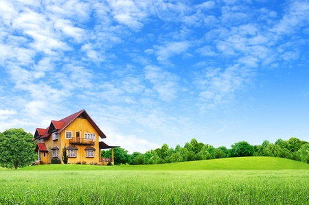 clouds: garden: House on green field landscape with blue sky Stock Photo