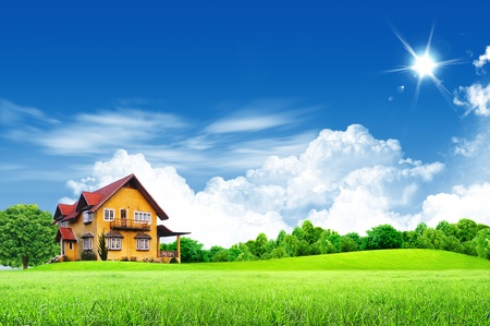 House on green field landscape with blue sky Stock Photo