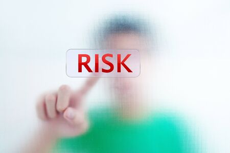 Businessman point finger on RISK wording photo