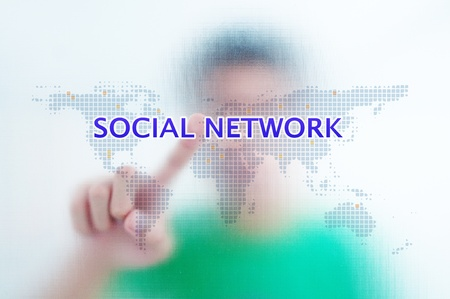 Businessman point finger on social network wording Stock Photo - 11071347