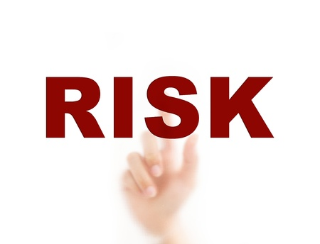 Finger pointing RISK, for risk management concept photo