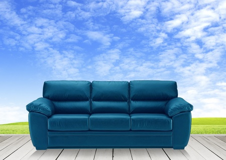 Wooden terrace and blue sofa photo
