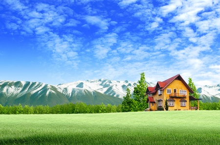 vista: House and moutain on green field landscape with blue sky