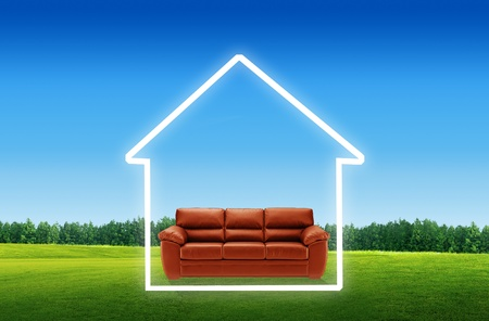 outdoor furniture: Red sofa on a green landscape,The House with blue sky as a symbol of the real estate business.