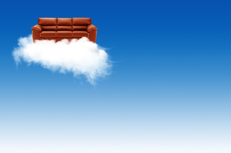 Red sofa on the cloud with blue sky background photo