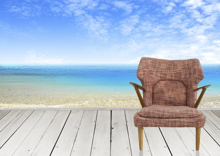 Wooden terrace and brown chair with seascape photo