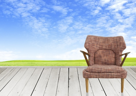 Wooden terrace and brown chair with landscape photo